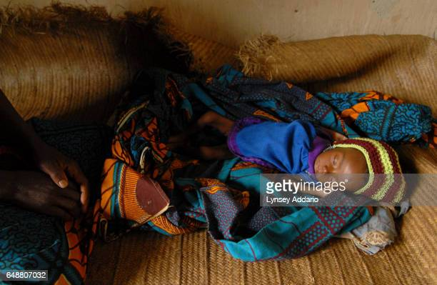 Neena Ngosi 3 months weighing about five pounds lies severely malnourished near her mother Ngava in a medical center on the outskirts of Geti Ituri...