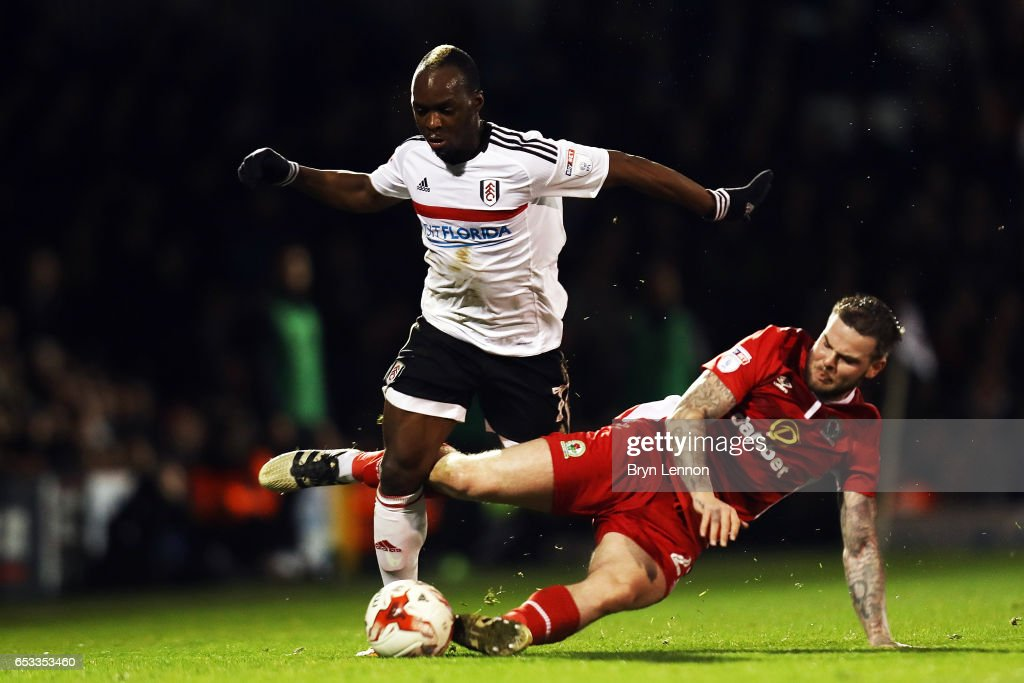 Neeskens Kebano of Fulham is tackled by Danny Gutherie of Blackburn Rovers during the Sky Bet Championship match between Fulham and Blackburn Rovers at Craven Cottage on March 14, 2017 in London, England.