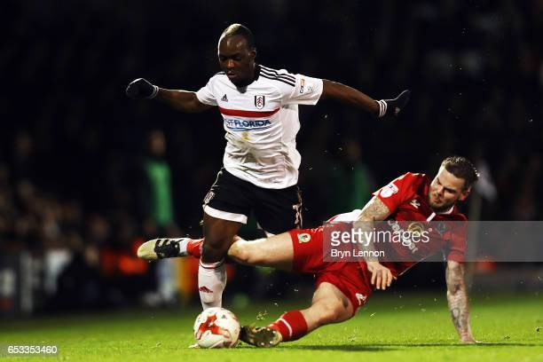 Neeskens Kebano of Fulham is tackled by Danny Gutherie of Blackburn Rovers during the Sky Bet Championship match between Fulham and Blackburn Rovers...