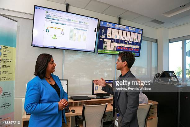 Neetika Sathe VP of smart grid technologies and Shuvo Chowdhury smart grid project lead at utility PowerStream pose at the company's offices in...