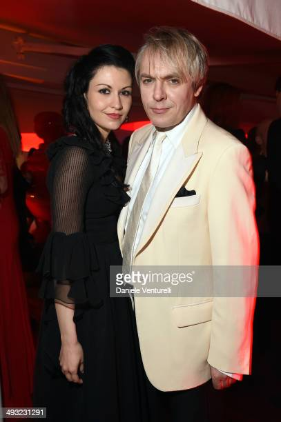 Nefer Suvio and Nick Rhodes attend the Moncler The After Party To Benefit amfAR at Hotel du CapEdenRoc on May 22 2014 in Cap d'Antibes France