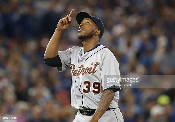 Neftali Feliz of the Detroit Tigers celebrates after getting the last out of the eighth inning during MLB game action against the Toronto Blue Jays...