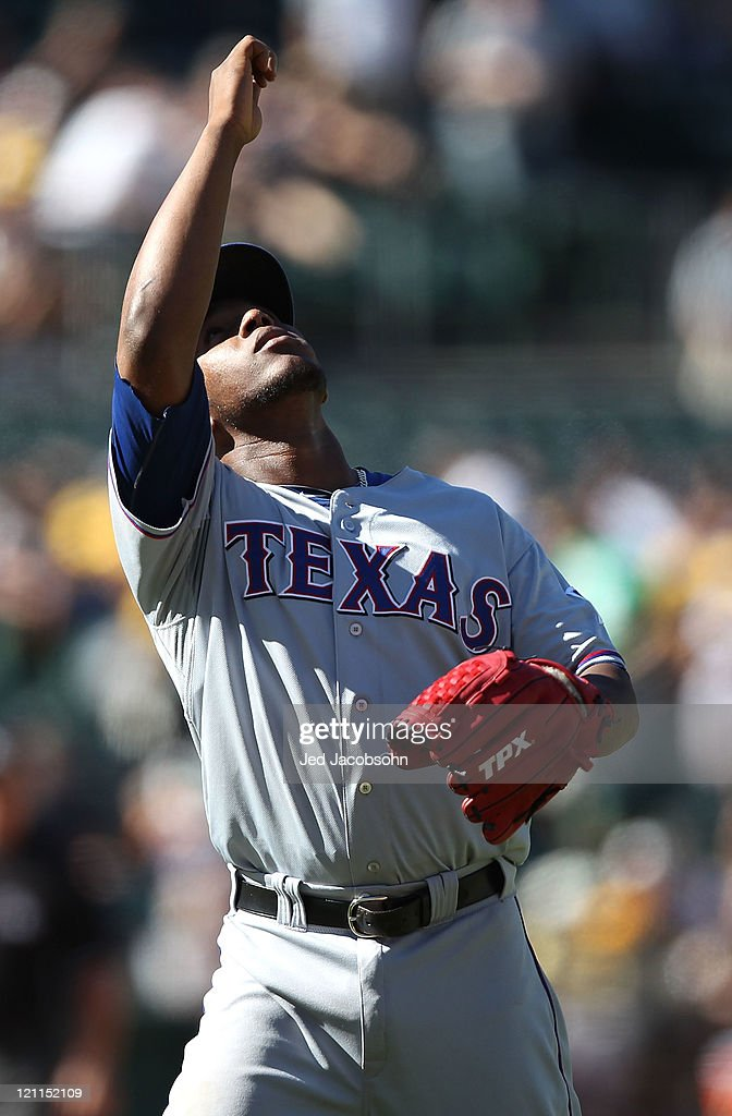 <a gi-track='captionPersonalityLinkClicked' href=/galleries/search?phrase=Neftali+Feliz&family=editorial&specificpeople=5753005 ng-click='$event.stopPropagation()'>Neftali Feliz</a> #30 of the Texas Rangers celebrates after defeating the Oakland Athletics at O.co Coliseum on August 14, 2011 in Oakland, California.