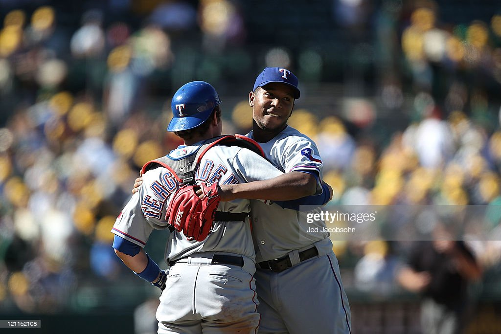 <a gi-track='captionPersonalityLinkClicked' href=/galleries/search?phrase=Neftali+Feliz&family=editorial&specificpeople=5753005 ng-click='$event.stopPropagation()'>Neftali Feliz</a> #30 of the Texas Rangers celebrates with Taylor Teagarden #2 after defeating the Oakland Athletics at O.co Coliseum on August 14, 2011 in Oakland, California.