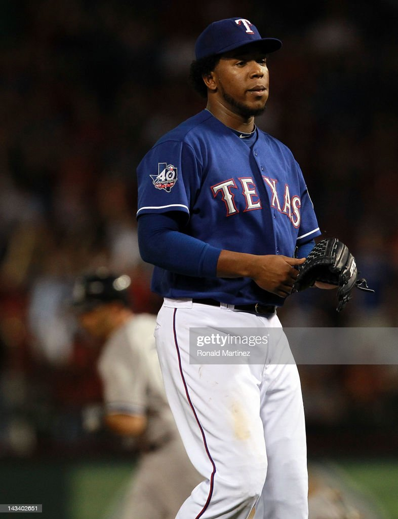 <a gi-track='captionPersonalityLinkClicked' href=/galleries/search?phrase=Neftali+Feliz&family=editorial&specificpeople=5753005 ng-click='$event.stopPropagation()'>Neftali Feliz</a> #30 of the Texas Rangers steps off the mound after giving up a home run against Raul Ibanez #27 of the New York Yankees at Rangers Ballpark in Arlington on April 25, 2012 in Arlington, Texas.