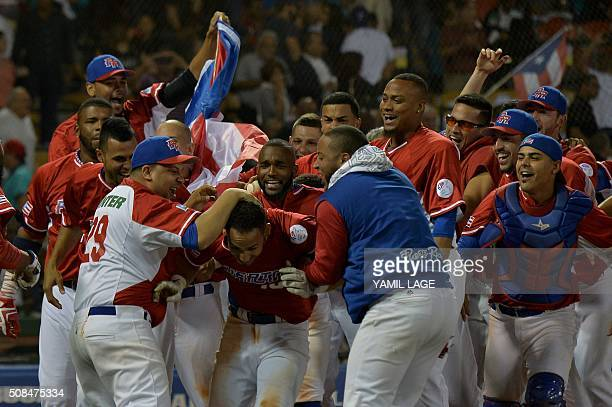 TOPSHOT Neftali Soto of Puerto Rican celebrates a homerun definitive against Dominican Republic during their 2016 Caribbean baseball series game on...