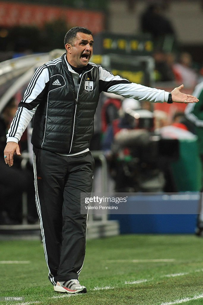 Neftci PFK head coach Boyukagha Hajiyev shouts to his players during the UEFA Europa League group H match between FC Internazionale Milano and Neftci PFK on December 6, 2012 in Milan, Italy.