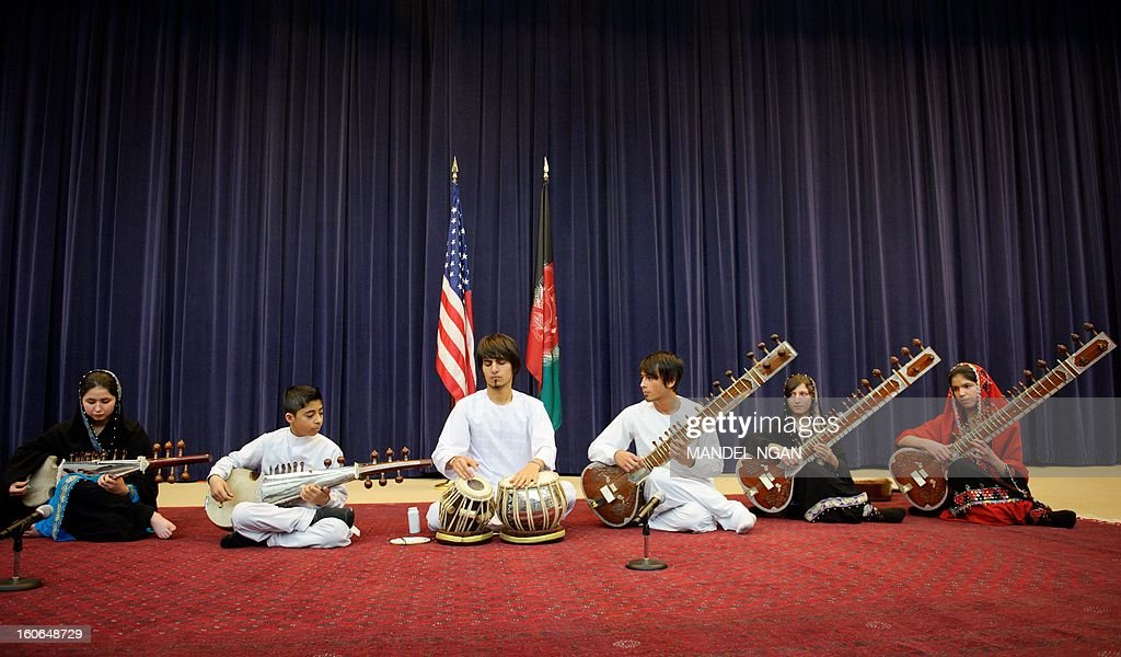 Negin Khpolwak (L), Gulalai Norestani (2nd R) and Huma Rahimy (R), members of the Afghanistan National Institute of Music Sitar and Sarod Ensemble, perform in the Dean Aceson Auditorium on February 4, 2013 in Washington, DC. The performance kicks of a three-city tour of the US. AFP PHOTO/Mandel NGAN