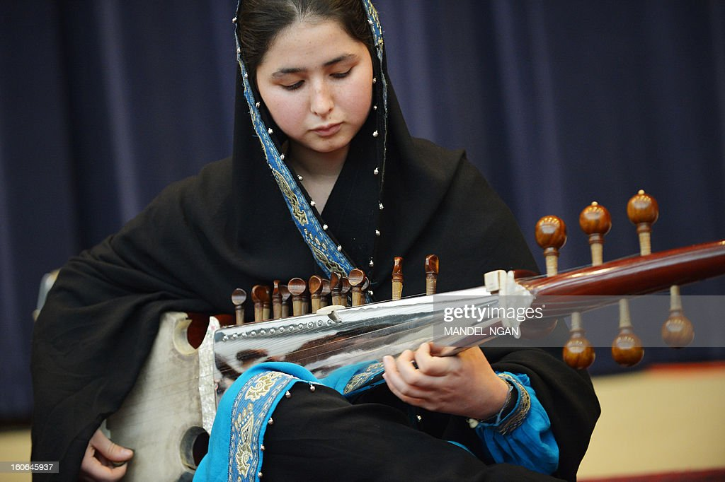 Negin Khpolwak, of the Afghanistan National Institute of Music Sitar and Sarod Ensemble, performs in the Dean Aceson Auditorium on February 4, 2013 in Washington, DC. The performance kicks of a three-city tour of the US. AFP PHOTO/Mandel NGAN
