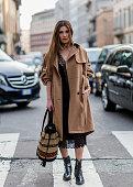 Negin Mirsalehi is wearing a Albertra Feretti dress and bag seen outside Alberta Ferretti during Milan Fashion Week Fall/Winter 2016/17 on February...