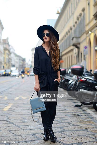 Negin Mirsalehi poses wearing Vince dress Jil Sander bag Acne shoes and The Row sunglasses on September 19 2014 in Milan Italy