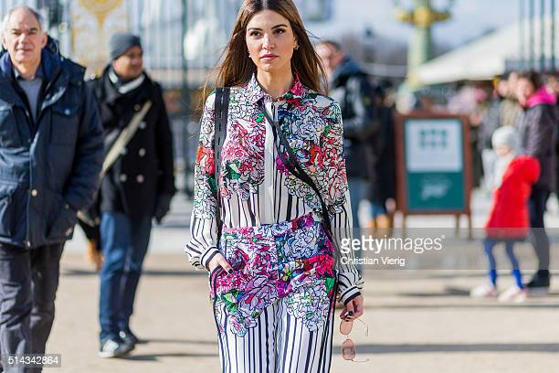 Negin Mirsalehi wearing a white suit with floral print from Elie Saab outside Elie Saab during the Paris Fashion Week Womenswear Fall/Winter...