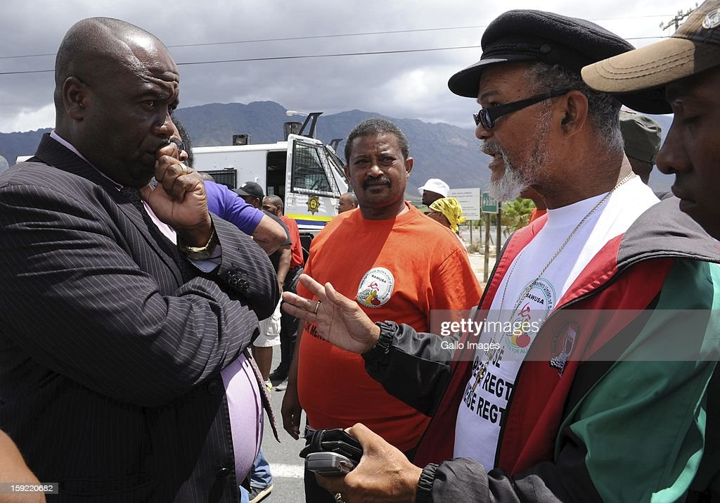 Negotiations on the N1 highway near De Doorns on January 9, 2013, in Cape Town, South Africa. Protesting farm workers shut down the N1 by lighting tires on fire and placing large rocks on the road.