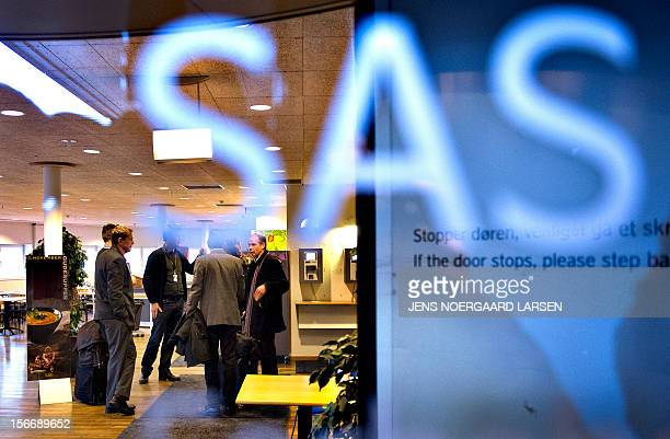 Negotiators gather inside the SAS headquarters at Kastrup Airport in Copenhagen Denmark on November 19 2012 during the negotiations with the SAS...