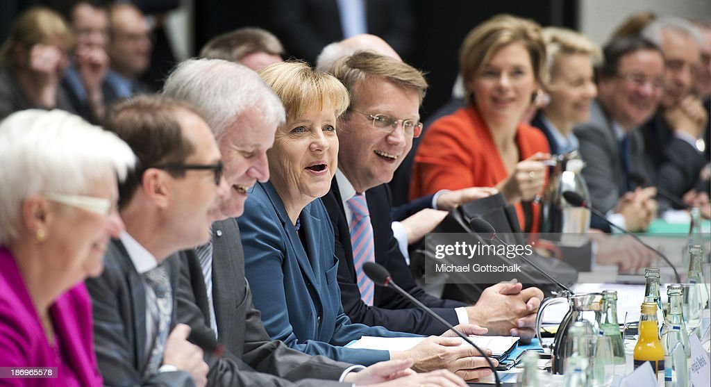 Negotiators including <a gi-track='captionPersonalityLinkClicked' href=/galleries/search?phrase=Horst+Seehofer&family=editorial&specificpeople=4273631 ng-click='$event.stopPropagation()'>Horst Seehofer</a> (3rd L), Prime Minister of German State Bavaria, German Chancellor <a gi-track='captionPersonalityLinkClicked' href=/galleries/search?phrase=Angela+Merkel&family=editorial&specificpeople=202161 ng-click='$event.stopPropagation()'>Angela Merkel</a> (4th L), and Head of the German Chancellery <a gi-track='captionPersonalityLinkClicked' href=/galleries/search?phrase=Ronald+Pofalla&family=editorial&specificpeople=657117 ng-click='$event.stopPropagation()'>Ronald Pofalla</a> (5th L), sit down during negotiations between the German Social Democrats (SPD), German Christian Democrats (CDU) and German Christian Social Democrats at the Bavarian state representation on November 5, 2013 in Berlin, Germany. The SPD, CSU and CDU are hashing through policy issues in an effort to create a new German colaition government following elections in September.