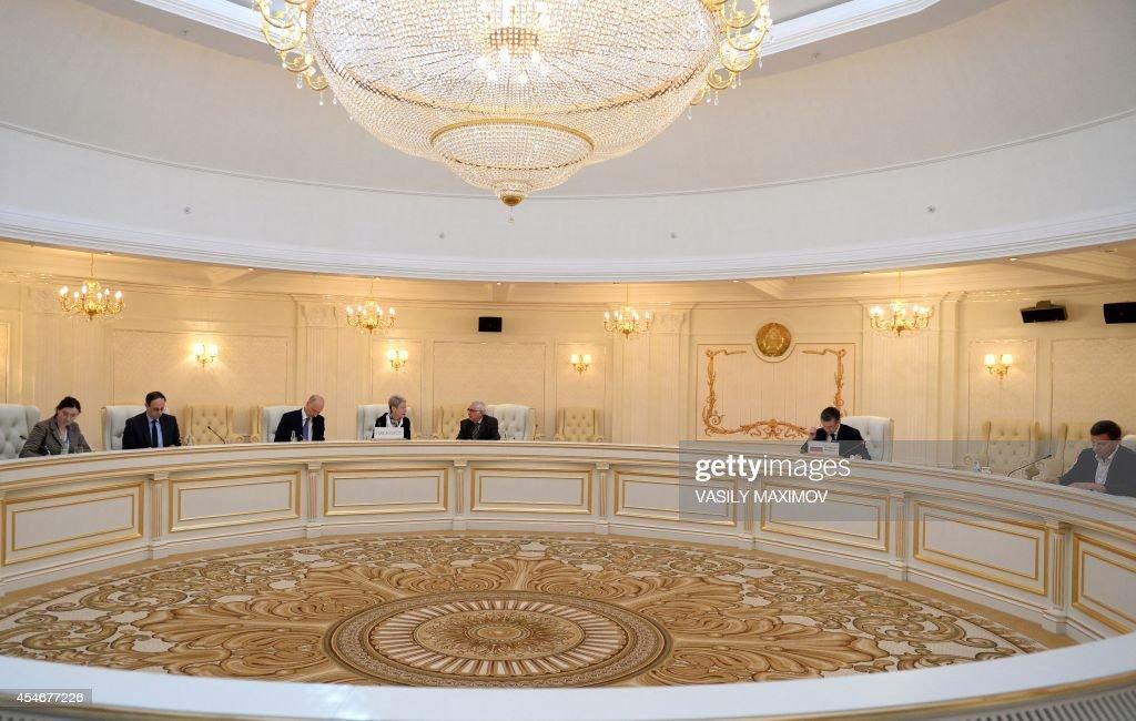 Negotiators of a contact group on Ukraine Organization for Security and Cooperation in Europe Ambassador Heidi Tagliavini Russian ambassador to...