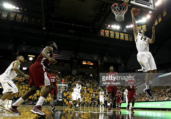 Negus WebsterChan of the Missouri Tigers grabs a rebound during the game against the South Carolina State Bulldogs at Mizzou Arena on December 17...