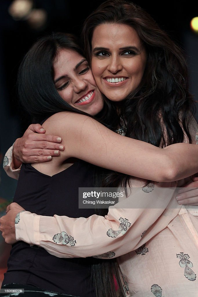 <a gi-track='captionPersonalityLinkClicked' href=/galleries/search?phrase=Neha+Dhupia&family=editorial&specificpeople=2195000 ng-click='$event.stopPropagation()'>Neha Dhupia</a> (R) walks the runway with Nishka Lulla (L) at the India International Jewellery Week 2012 Day 4 at the Grand Hyatt on August 22, 2012 in Mumbai, India.