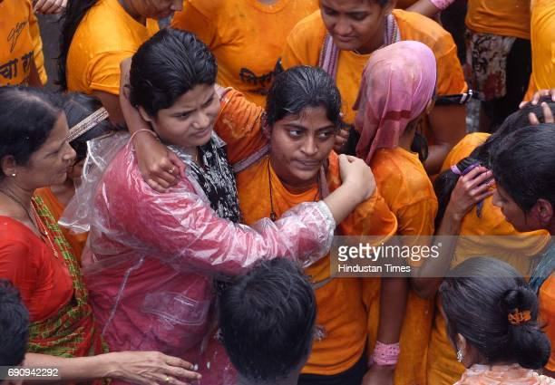 Neha Kadam amongst the women Govindas of Girgaumcha Raja Mahila Govinda Pathak injured after breaking the Dahi handi of 10th lane in Kamathipura