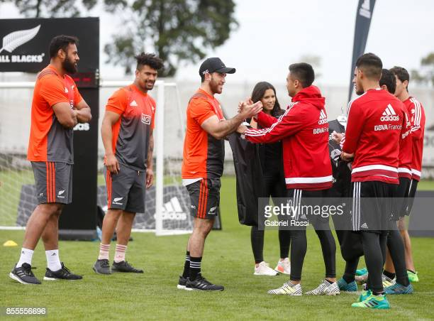 Nehe MilnerSkudder of All Blacks exchanges jerseys with Gonzalo Martinez of River Plate during the New Zealand Rugby Championship Media Day ahead of...