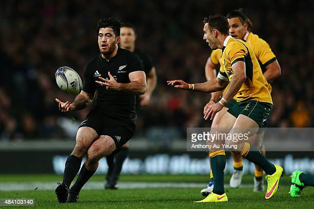 Nehe MilnerSkudder of New Zealand makes a pass against Nic White of Australia during The Rugby Championship Bledisloe Cup match between the New...