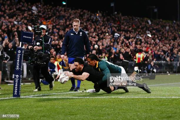 Nehe MilnerSkudder of the All Blacks scores a try against Courtnall Skosan of South Africa during the Rugby Championship match between the New...