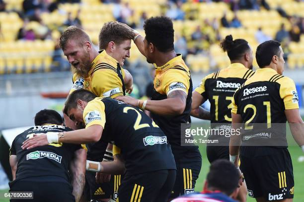 Nehe MilnerSkudder of the Hurricanes is congratulated by teammates during the round two Super Rugby match between the Hurricanes and the Rebels at...