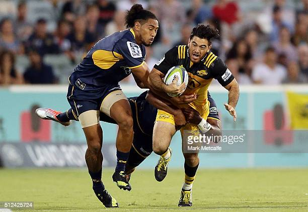 Nehe MilnerSkudder of the Hurricanes is tackled during the round one Super Rugby match between the Brumbies and the Hurricanes at GIO Stadium on...