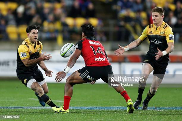 Nehe MilnerSkudder of the Hurricanes passes to teammate Jordie Barrett during the round 17 Super Rugby match between the Hurricanes and the Crusaders...