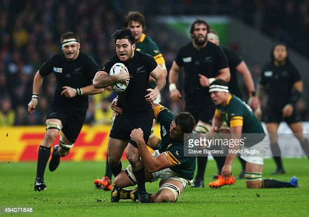 Nehe MilnerSkudder of the New Zealand All Blacks is tackled by Eben Etzebeth of South Africa during the 2015 Rugby World Cup Semi Final match between...