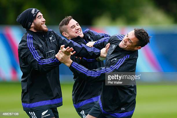 Nehe MilnerSkudder TJ Perenara and Daniel Carter of the All Blacks warm up during a New Zealand All Blacks training session on September 15 2015 in...