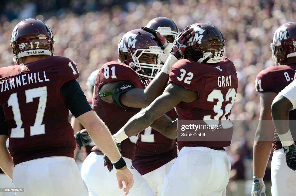 Nehemiah Hicks #81 celebrates with teammate Cyrus Gray #32 of the Texas A&M Aggies after a touchdown during a game against the Missouri Tigers at Kyle Field on October 29, 2011 in College Station, Texas.