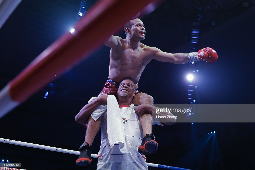 Nehomar Cermeno of Venezuela celebrates his victory over Qiu Xiaojun of China during their WBA world super bantamweight championship belt match at Capital Indoor Stadium on June 24, 2016 in Beijing, China.