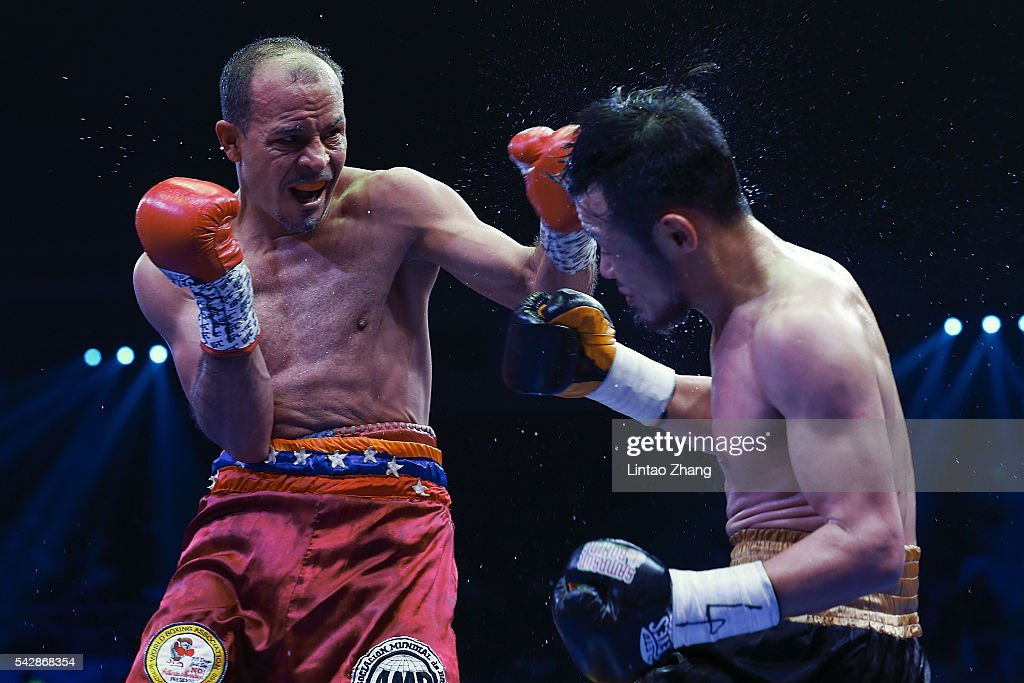 Nehomar Cermeno of Venezuela delivers a punch to Qiu Xiaojun of China during their WBA world super bantamweight championship belt match at Capital Indoor Stadium on June 24, 2016 in Beijing, China.