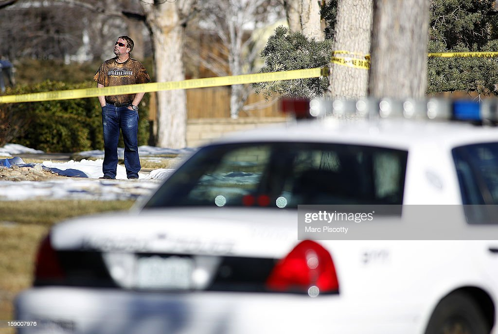 Neighbor Michael Ignace of Aurora, Colorado takes in the scene where four people were killed Saturday morning including the gunman who held police at bay for several hours at the complex January 5, 2013 in Aurora, Colorado. Aurora SWAT team members shot a gunman after he went to a second-floor window and fired at police. The gunman also allegedly fatally shot two men and a woman that he had taken hostage. One woman managed to escape from an upstairs back window, ran from the home and called police just before 3 a.m., said Cassidee Carlson, Aurora police spokeswoman.