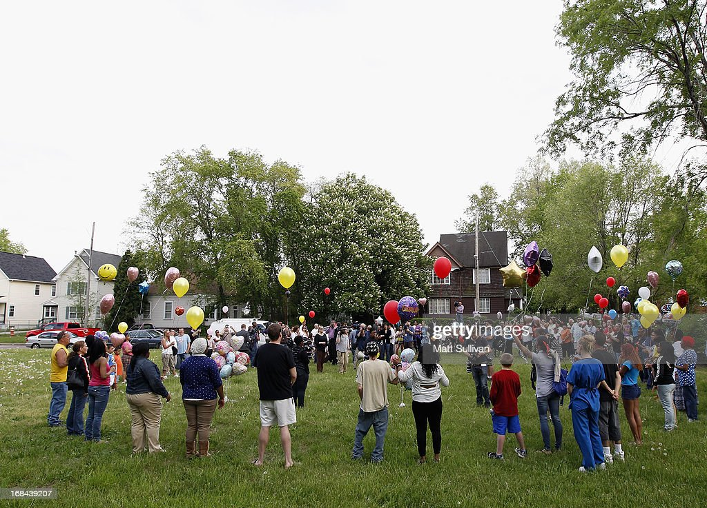 Neighborhood residents where three girls were held captive hold hands during a vigil on May 9, 2013 in Cleveland, Ohio. Ariel Castro was arraigned on rape and kidnapping charges for abducting Michelle Knight, Amanda Berry and Gina DeJesus and holding them for about 10 years. No charges were filed against his brothers Onil or Pedro and they were released by the judge. Bail was set at $8 million for Ariel.