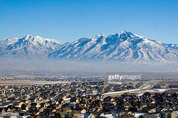 Neighborhood Under Snow-Capped Mountains