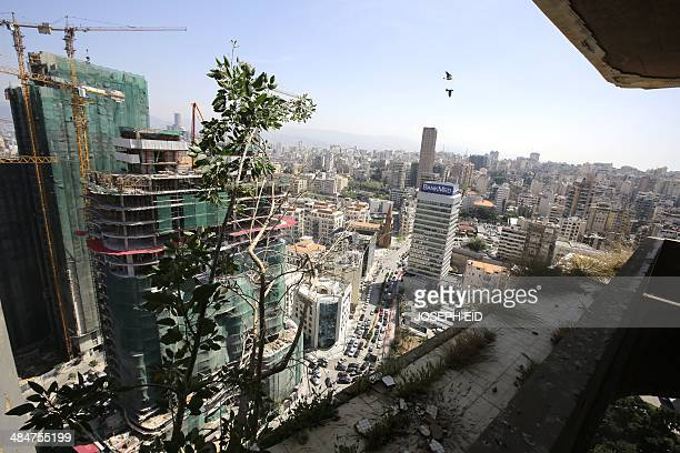 Neighborhoods of east Beirut are seen from the 25th floor of the Holiday Inn hotel in the lebanese capital on April 11 as the nation marks 39years...