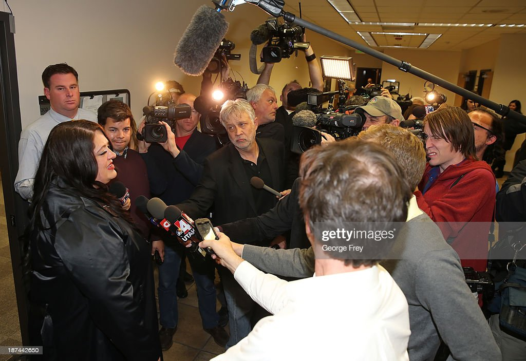 Neighbors of Martin MacNeill talk to the media after he was found guilty of the murder of his wife Michele MacNeill on November 9, 2013 in Provo, Utah. Martin MacNeill was found guilty of murdering his wife Michele MacNeill in 2007 and will face up to life in prison when he is sentenced in January.