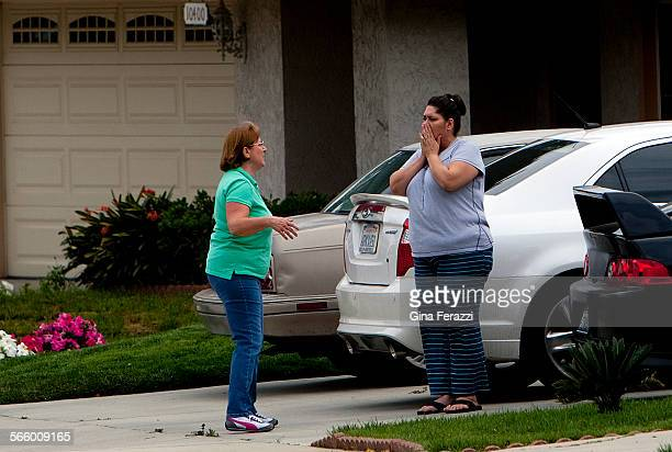 Neighbors react upon hearing the news that a 65yearold woman was killed a few houses away in the 10300 block of Key West Street on March 31 2013 in...