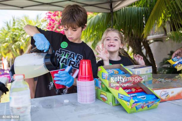 Neighbors set up vending booths on their lawns at the dedication of Mark Hamill Drive on July 30 2017 in San Diego California