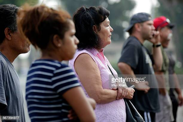 RIVERA CA AUGUST 02 2014 Neighbors watch and watch Los Angeles County Sheriff's detectives investigate on August 02 2014 at 9000 block of Rosehedge...