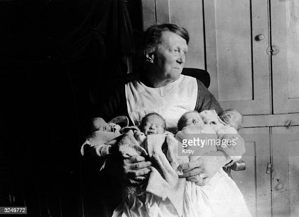Mrs Watson's neighbour with her four baby quads three boys and a girl