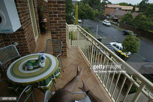 A neighbour of 95 Croydon Street Lakemba sits on his balcony where he observed raids on Croydon Street on the opposite side of the street NSW police...