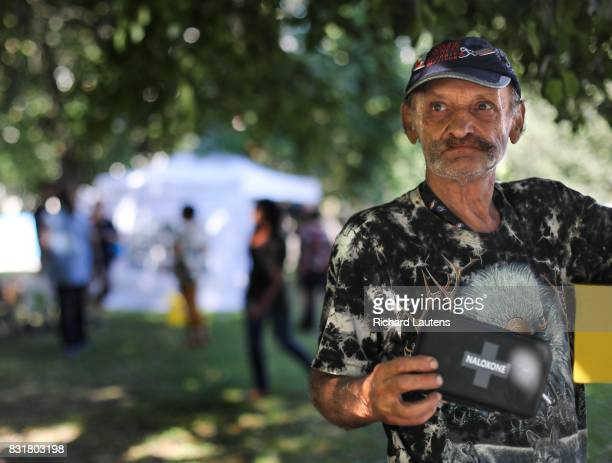 TORONTO ON AUGUST 14 Neighbourhood resident Clifford checks out a Naloxone kit he was given as the pop up clinic With an epidemic of overdose deaths...