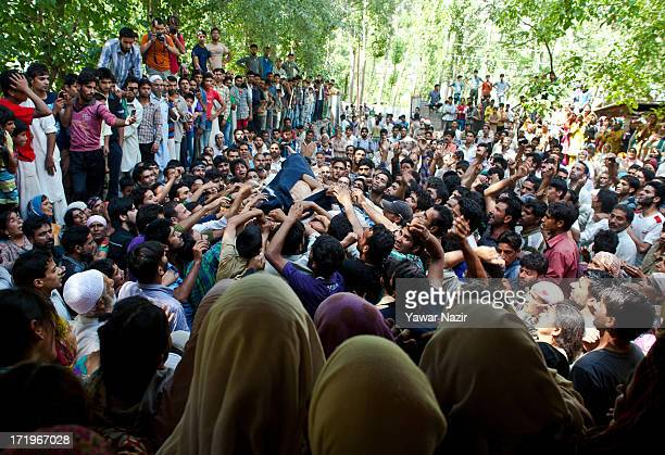Neighbours and relatives carry the body of Tariq Ahmed a civilian who was killed by Indian army during his funeral on June 30 2013 in Kondebal 25 km...
