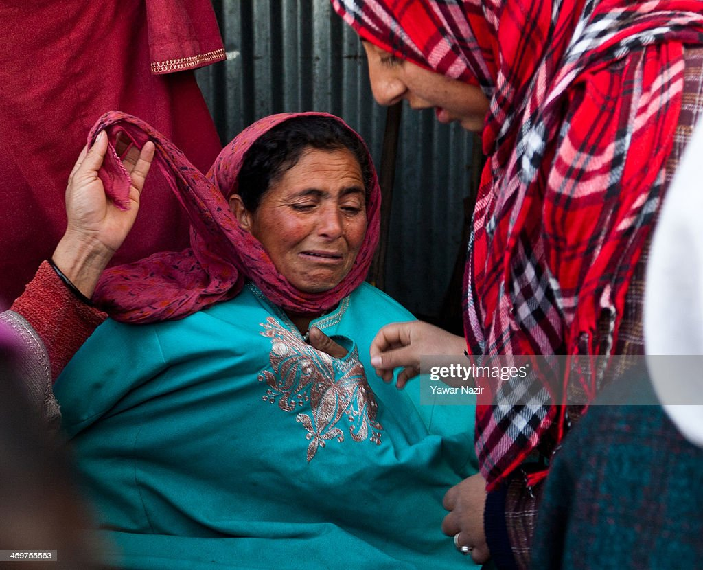 Neighbours console a Kashmiri woman as she sits on the debris of her house after a fire gutted many residential houses on December 30, 2012, in Srinagar, the summer capital of Indian administered Kashmir, India. Many families were left homeless amid sub-zero temperatures during the harshest 40-day period (Chilay Kalan) of the winter, after at least 30 residential houses were damaged in a devastating fire on the bank of famous Dal Lake near the Hazratbal shrine, in the outskirts of the Srinagar. The incident engulfed the area during the preceding night, an official said. No injuries were reported.