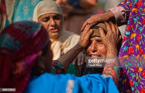 Neighbours console a relative of Irshad Ahmad Ganie a militant commander who was killed in a gun battle between him and Indian government forces...