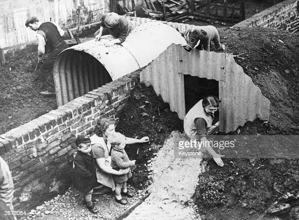 Neighbours putting up Anderson Air Raid Shelters in their gardens during the Second World War