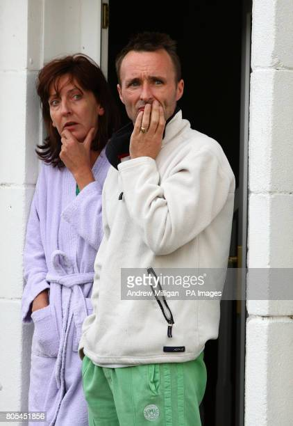 Neighbours Samantha Burns and Billy Nugent look out from their front door after speaking to the media in Devondale Avenue in Blantyre after a house...